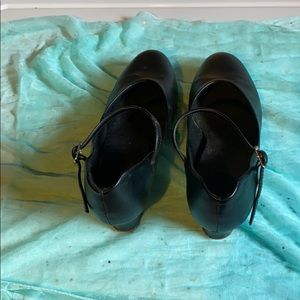 Black dress shoe.